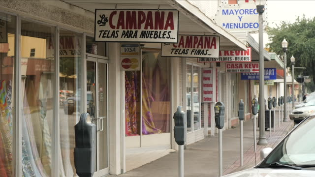 exterior shots of street scenes around mcallen, texas with various hispanic restaurants and other businesses lining the main street on 1 july 2018 in... - mcallen texas stock videos & royalty-free footage