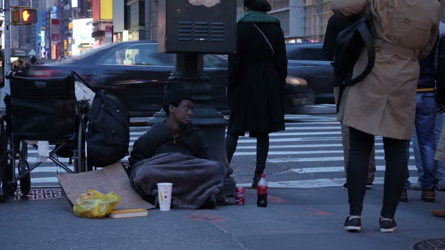 exterior shots of street scenes in manhattan including a woman buying a drink at a hot dog cart and pedestrians walking along and passing a homeless... - cart stock videos & royalty-free footage