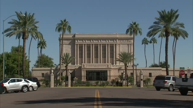 exterior shots of street scenes in mesa arizona including shots of the gated entrance to a mormon temple and traffic and pedestrians in downtown mesa - mormonism stock videos & royalty-free footage
