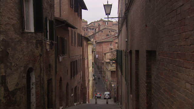exterior shots of street scenes in siena - tuscany stock videos & royalty-free footage