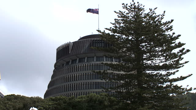Exterior shots of street scenes in Wellington and the New Zealand flag flying above the parliament building known as the 'Beehive'>> on October 19...