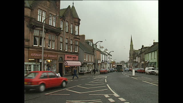 exterior shots of street scenes traffic and local landmarks in the town of lockerbie approximately three months after the pan american flight 103 en... - dumfries and galloway stock videos & royalty-free footage