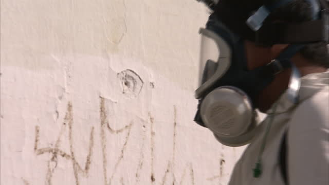 exterior shots of streets, buildings and plants being sprayed with a fumigator on january 25, 2016 in recife, brazil. - virus zika video stock e b–roll