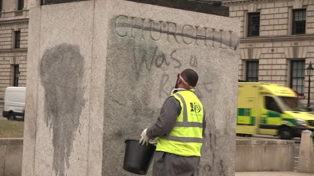 exterior shots of streets grafitti being removed from a winston churchill statue following black lives matter protests on 7th june 2020 in... - statue stock videos & royalty-free footage