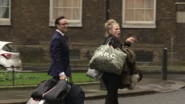 exterior shots of strictly come dancing's kellie bright walking from number 11 downing street with dance partner kevin clifton after the annual... - チャンセラー点の映像素材/bロール