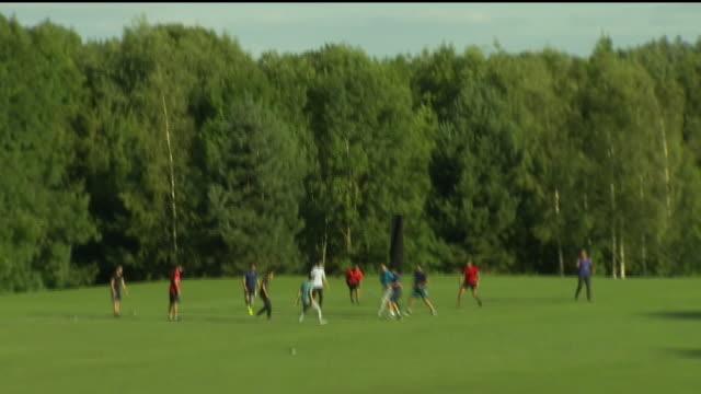 exterior shots of students playing football at warwick university. - torschuss stock-videos und b-roll-filmmaterial