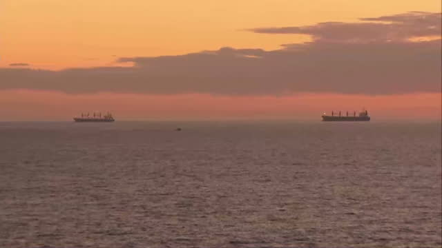Exterior shots of sun setting over the Indian Ocean Merchant Ships on horizon with beautiful sunset on April 10 2014 in Perth Australia
