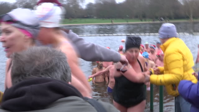 exterior shots of swimmers getting out of the serpentine lake in london's hyde park after the annual peter pan cup on christmas day on 25 december... - the serpentine london stock videos & royalty-free footage