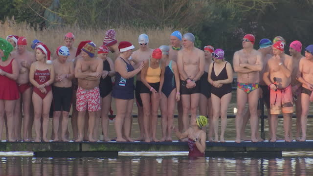 exterior shots of swimmers getting ready for the annual christmas day swim in the serpentine in hyde park on 25th december 2019 in london england - the serpentine london stock videos & royalty-free footage