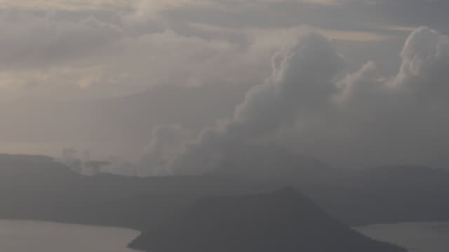 exterior shots of taal volcano spewing smoke and ash on 15 january 2020 in laurel in batangas province philippines - taal volcano stock videos & royalty-free footage