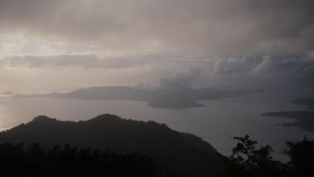 exterior shots of taal volcano spewing smoke and ash on 15 january 2020 in talisay batangas philippines - taal volcano stock videos & royalty-free footage