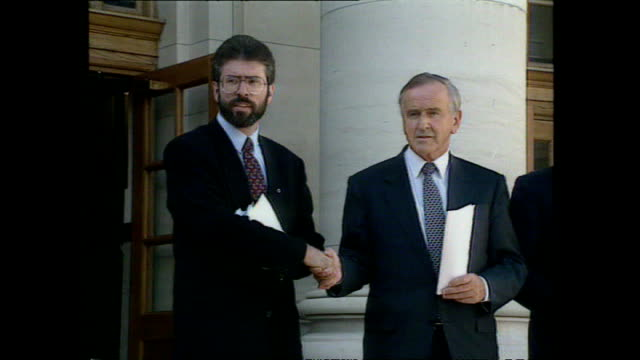 exterior shots of taoiseach albert reynolds gerry adams and john hume posing for a photo op after the signing of the anglo irish agreement on... - gerry adams stock videos and b-roll footage
