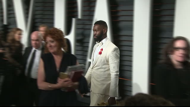 exterior shots of tarell alvin mccraney winner of the best adapted screenplay oscar arriving at the vanity fair oscars party on february 27 2017 in... - oscar party stock-videos und b-roll-filmmaterial