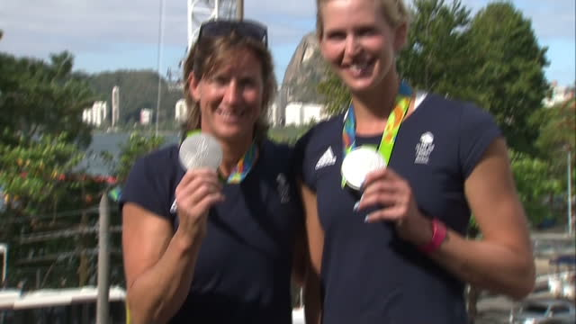 exterior shots of team gb double skulls rowers and olympic medalists victoria thornley and katherine grainger posing with silver medals. on august... - olympische spiele stock-videos und b-roll-filmmaterial