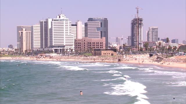 vídeos de stock, filmes e b-roll de exterior shots of tel aviv beachfront with city skyline in background tel aviv and jaffa general views on september 11 2013 in tel aviv israel - visão geral