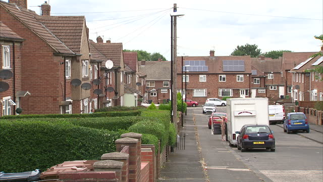 exterior shots of terraced houses and a nearby park with swings a slide and climbing frame with terraced houses in the background on july 28 2016 in... - terraced house stock videos & royalty-free footage