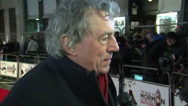 exterior shots of terry jones being interviewed on the red carpet at the book of mormon premiere at prince of wales theatre on march 21 2013 in... - monty python stock-videos und b-roll-filmmaterial