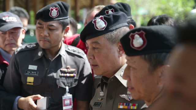 exterior shots of thailand's deputy police chief pol gen somyos pumpanmuang speaking in english at a press conference on koh tao beach about the... - police chief stock videos and b-roll footage