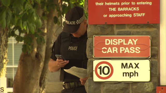 exterior shots of the 160 brigade headquarters including land rover driving thorugh checkpoint and mod signage. two soldiers die in the brecon... - brecon beacons video stock e b–roll