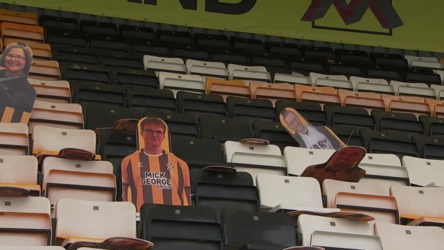 exterior shots of the abbey stadium's seats with cardboard cut-outs of cambridge united fans to sit in whilst people can't return to stadiums in the... - plain background stock videos & royalty-free footage