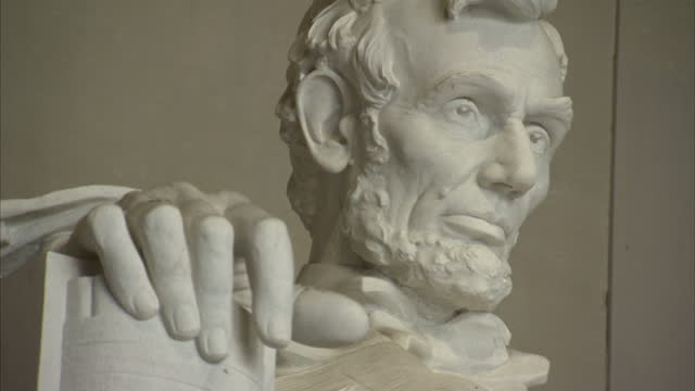 exterior shots of the abraham lincoln statue in the lincoln memorial and tourists inspecting it on june 10 2015 in washington dc - lincolndenkmal stock-videos und b-roll-filmmaterial