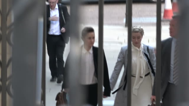 exterior shots of the actor amber heard walking hand in hand into the rear entrance of the royal courts of justice with girlfriend bianca butti on 21... - amber heard stock videos & royalty-free footage