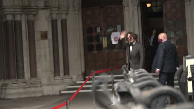 exterior shots of the actor johnny depp arriving at the high court wearing a mask before removing it to briefly wave to the press before walking in... - johnny depp stock videos & royalty-free footage
