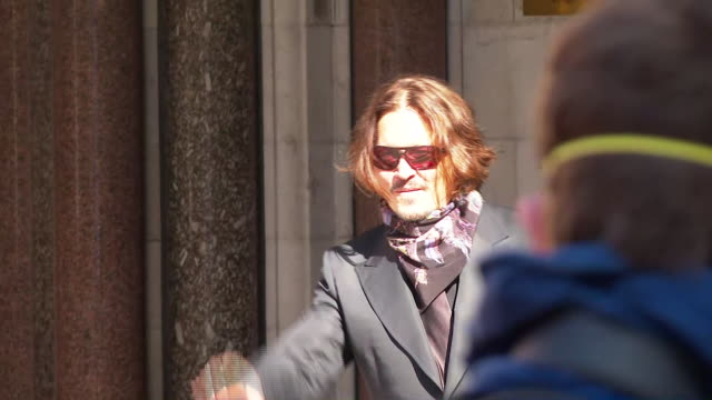 exterior shots of the actor johnny depp walking into the high court on day 10 of his libel trial against the sun waving to the media and crowds on... - sky only stock videos & royalty-free footage