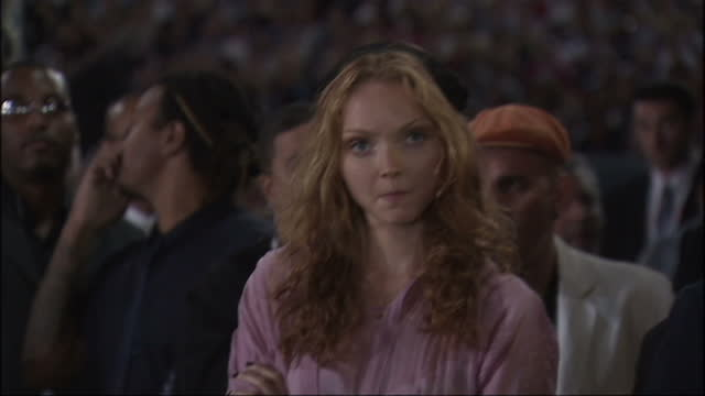 vídeos de stock e filmes b-roll de exterior shots of the actress and model lily cole sat in the audience for barack obama's 2008 acceptance speech on august 28 2008 in denver colorado - 2008