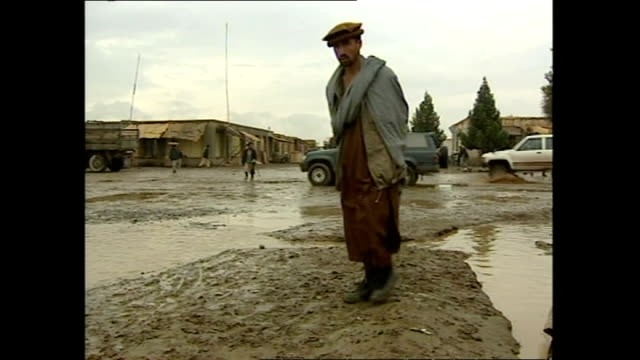 Exterior shots of the Afghan town of Khuj a Bahuddin after a rainstorm with local people walking through mud and puddles on October 27 2001 in Kabul...