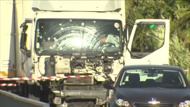 exterior shots of the aftermath of the nice terror attack with the gunshot riddled truck used in the attack and police at scene on december 13 2016... - terrorism bildbanksvideor och videomaterial från bakom kulisserna