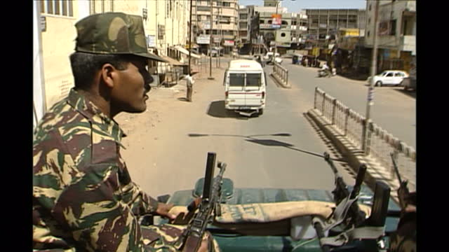 exterior shots of the army keeping order on the streets of gujarat in the wake of ethnic rioting on march 3rd 2002 in ayodhya india - グジャラート州点の映像素材/bロール