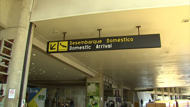exterior shots of the arrivals terminal at tancredo neves international airport with extensive construction work going on build up to 2014 world cup... - internationaler fußball stock-videos und b-roll-filmmaterial