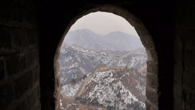 exterior shots of the badaling section of the great wall of china and snowcovered surrounding scenery scenic shots of the great wall of china on... - badaling great wall stock videos & royalty-free footage