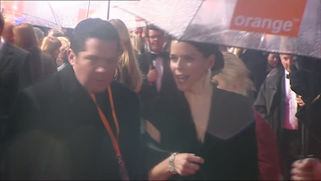 exterior shots of the bafta awards red carpet in the rain, footballer sol campbell walking down red carpet and actress neve campbell posing for... - neve stock videos & royalty-free footage