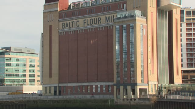 exterior shots of the baltic flour mill including shots of a boat going along the river tyne in gateshead on 24th march 2018 in tyne and wear united... - river tyne stock videos & royalty-free footage