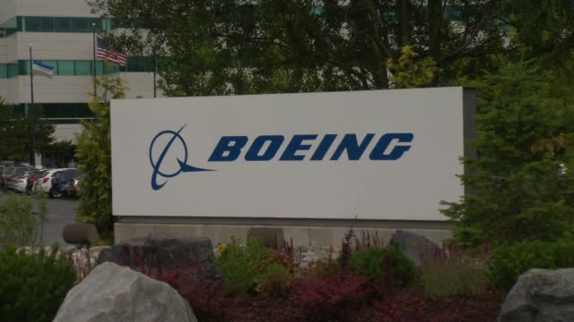 exterior shots of the boeing everett factory in everett washington wide and medium shot of beoing signage and landscaping shots of the boeing flag... - boeing stock videos & royalty-free footage