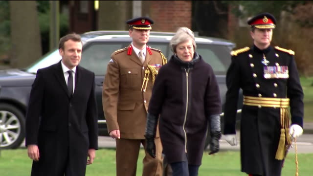 Exterior shots of the British and French national flags flying outside the Royal Military Academy Sandhurst and Prime Minister Theresa May greeting...