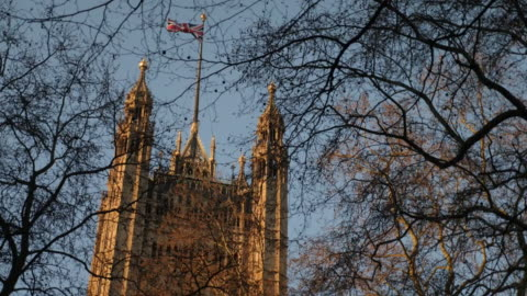 stockvideo's en b-roll-footage met exterior shots of the british flag waving on top of the victoria tower of the palace of westminster on 25th march 2020 in london, england - victoria tower
