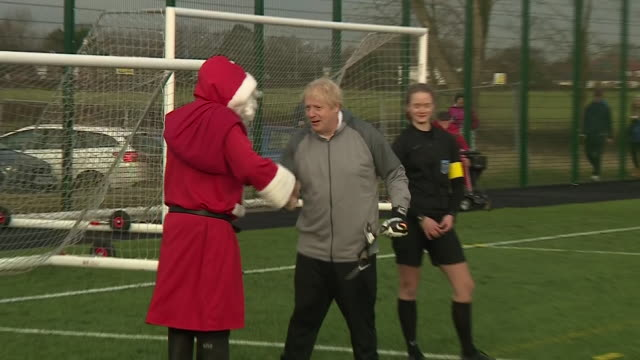 vidéos et rushes de exterior shots of the british prime minister boris johnson pm meeting santa claus during visit to the charity seashell trust on december 07, 2019... - boris johnson