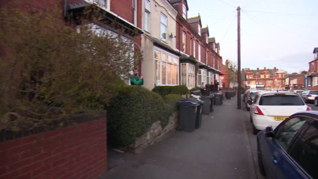 exterior shots of the british residents in birmingham clapping outside their homes in support of the nhs and medical workers keeping us safe during... - nhs stock videos & royalty-free footage
