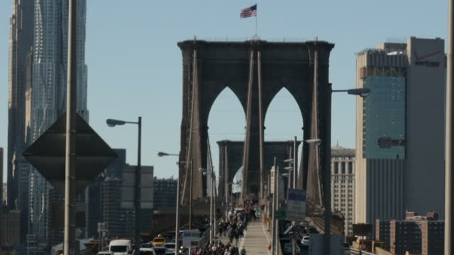 exterior shots of the brooklyn bridge including traffic and pedestrians crossing the bridge with manhattan skyscrapers in the background>> on... - brooklyn bridge stock videos & royalty-free footage