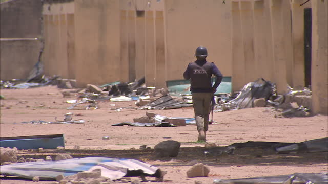 exterior shots of the burnt out school in chibok at which nearly 300 girls were kidnapped by boko haram with the charred remains of the classroom and... - 女子生徒点の映像素材/bロール