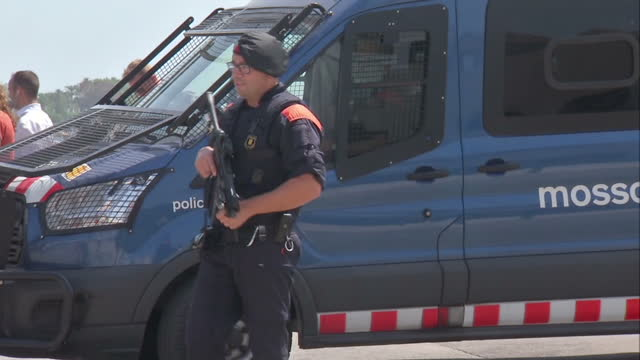 Exterior shots of the busy seafront and beach in Cambrils including shots of armed police on the streets following a terrorist attack on the town on...