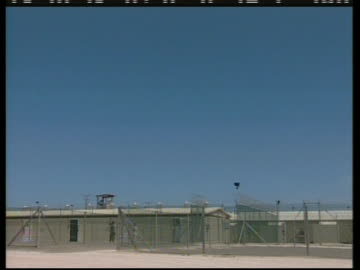 exterior shots of the camp delta section of guantanamo bay. - crime or recreational drug or prison or legal trial stock videos & royalty-free footage