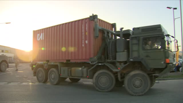 exterior shots of the car of poisoned ex-spy sergei skripal in a shipping container being driven from an industrial estate in a convoy of police and... - film container stock videos & royalty-free footage