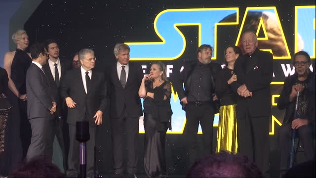 stockvideo's en b-roll-footage met exterior shots of the cast producers on stage at the premiere of star wars the force awakens at leicester square on december 16 2015 in london... - ensemble lid
