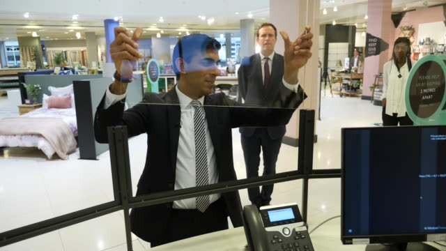 exterior shots of the chancellor of the exchequer, rishi sunak visiting a john lewis store as it prepares to open, speaking to staff and helping... - in front of stock videos & royalty-free footage