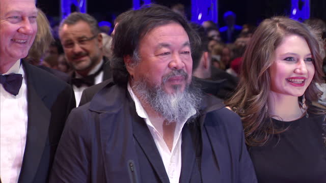 Exterior shots of the Chinese artist and dissident Ai Wei Wei posing for photos on the red carpet at the Berlin premiere of 'Hail Caesar' on February...