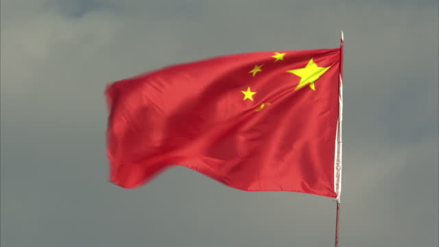 exterior shots of the chinese flag flying against a cloudy sky in urumqi>> on september 23 2015 in urumqi china - xinjiang province stock videos & royalty-free footage